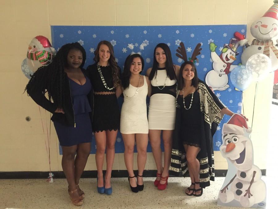 From left: BOE Representative Gifty Adombire, Vice President Carly Swetz, Secretary Kathy Chen, Treasurer Alex Chedid, and President Alia Rind take a moment to enjoy all their hard work preparing the evening for Snowball 2016.