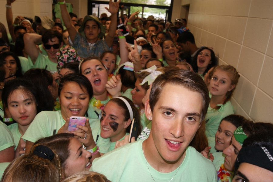 Senior Alex Romanoski leads the Sightseers into the gym for a successful Spirit Night.