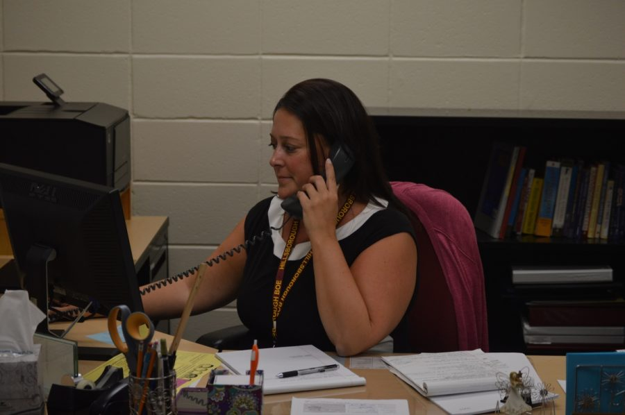 Director of Guidance Jessica Smedley fields a call at her new job.