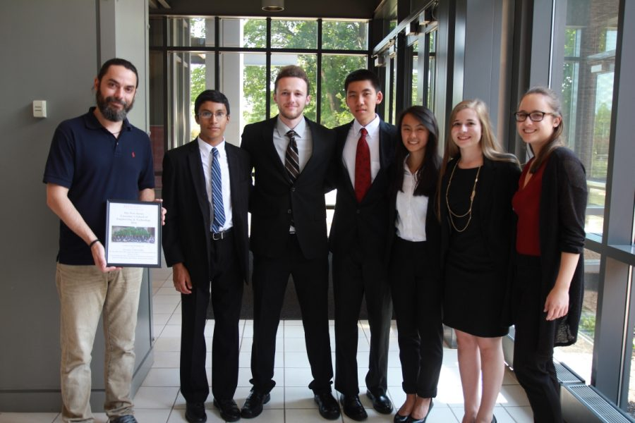 Senior Rebecca Della Croce, second from right, poses after presenting her final research project at Rutgers.