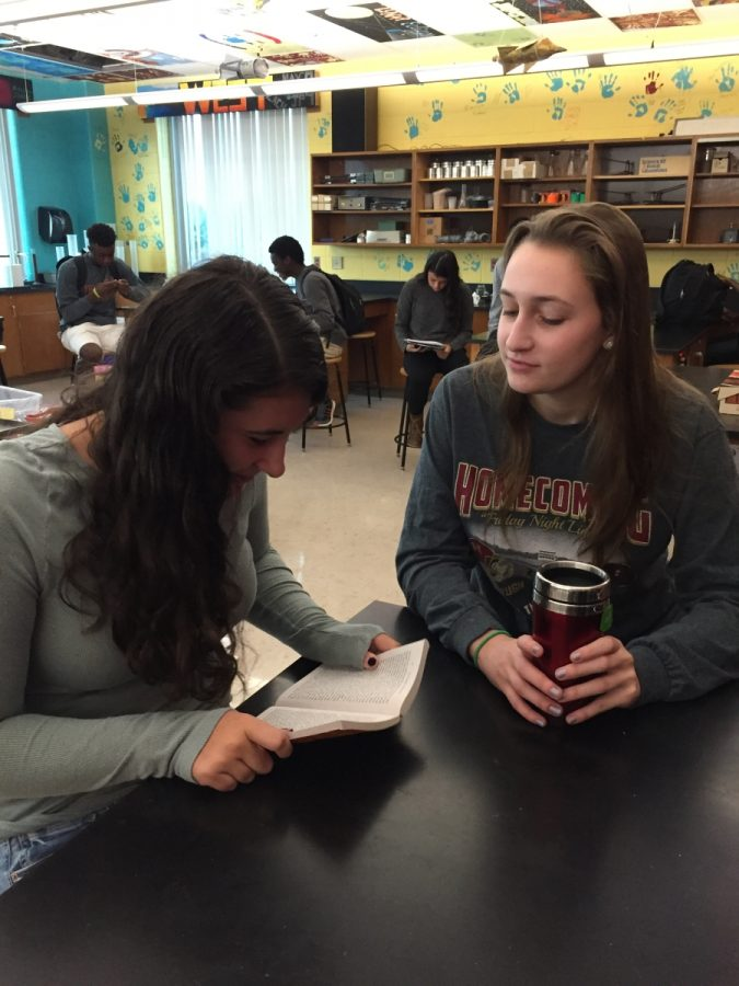 Juniors Caroline Pabst and Marissa Osofsky discuss the summer reading assignment in homeroom last week.