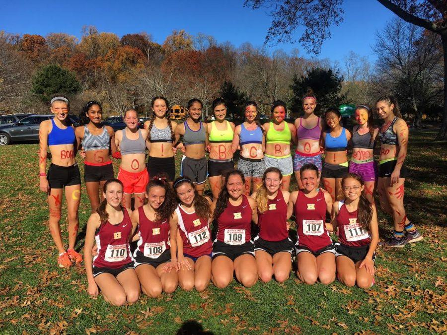 The 2016 girls cross country team poses at the Meet of Champions. The team finished 7th place at the prestigious event.