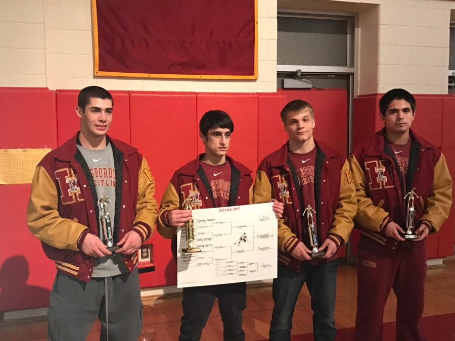 From+left+to+right%2C+juniors+Mike+Dinardi%2C+Anthony+Donnadio%2C+and+Kevin+Faulkner+pose+with+sophomore+Emilio+Guerrero+Nieto+and+some+hard-earned+hardware+after+the+East+Brunswick+Invitational.+The+team+finished+in+third+place.