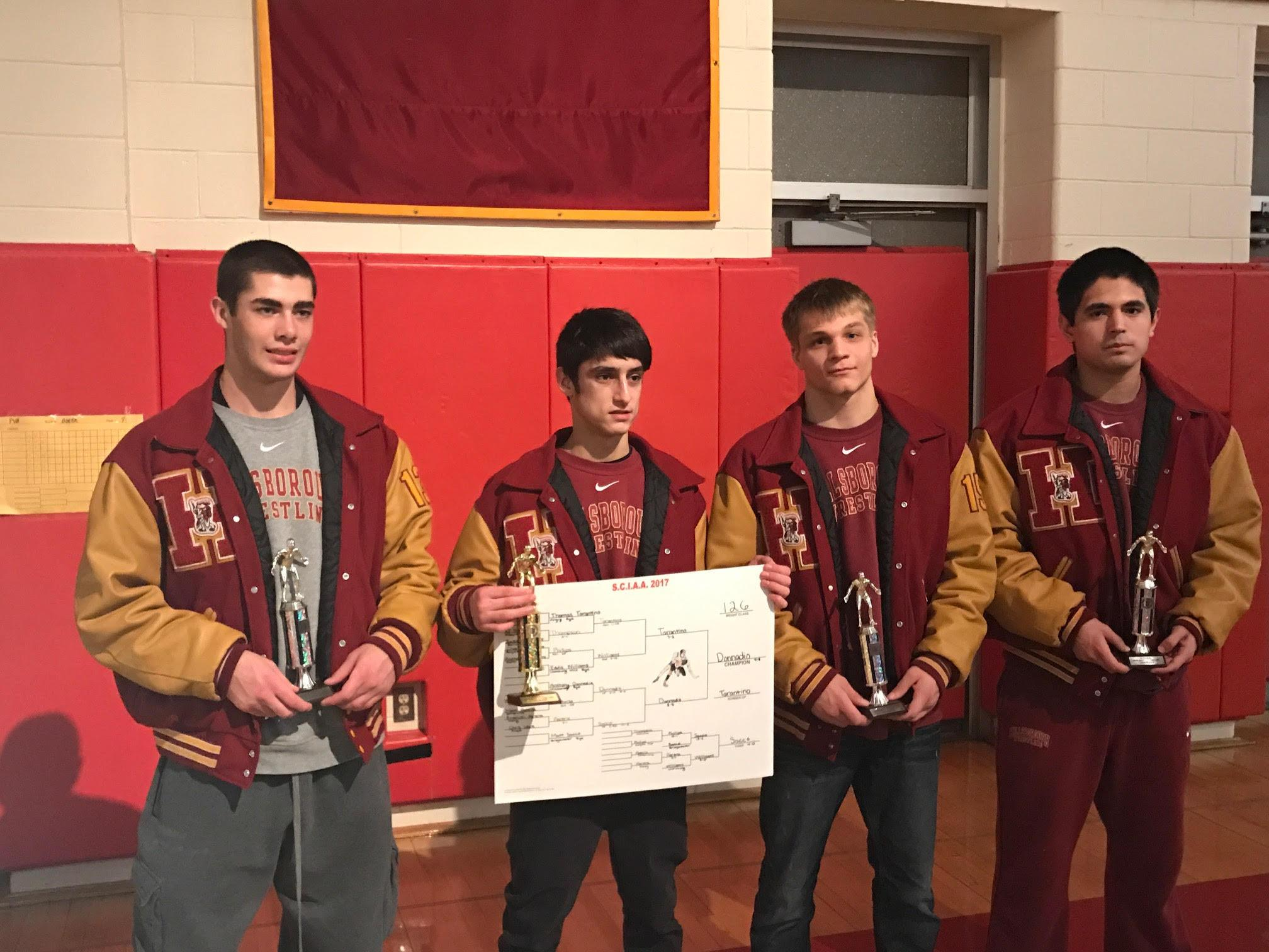 From left to right, juniors Mike Dinardi, Anthony Donnadio, and Kevin Faulkner pose with sophomore Emilio Guerrero Nieto and some hard-earned hardware after the East Brunswick Invitational. The team finished in third place.