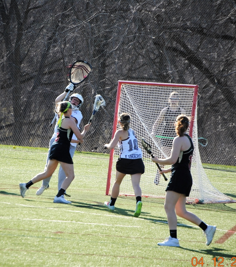 Junior Olivia Johnsen attempts to put the ball in the net. Johnsen was instrumental in the team's first victory.