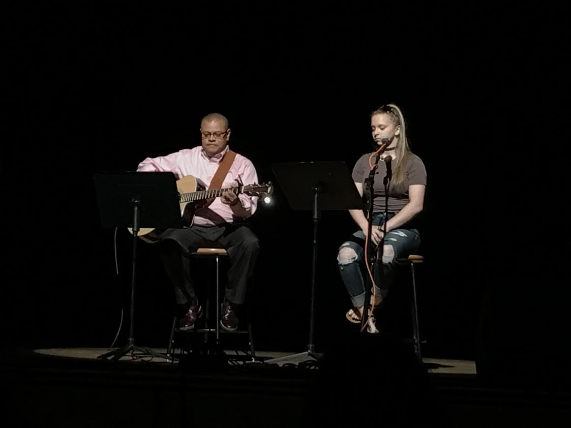 Student assistance counselor Gil Pilarte and junior Stella Pashaian performing a Bob Dylan tune at Unplugged.