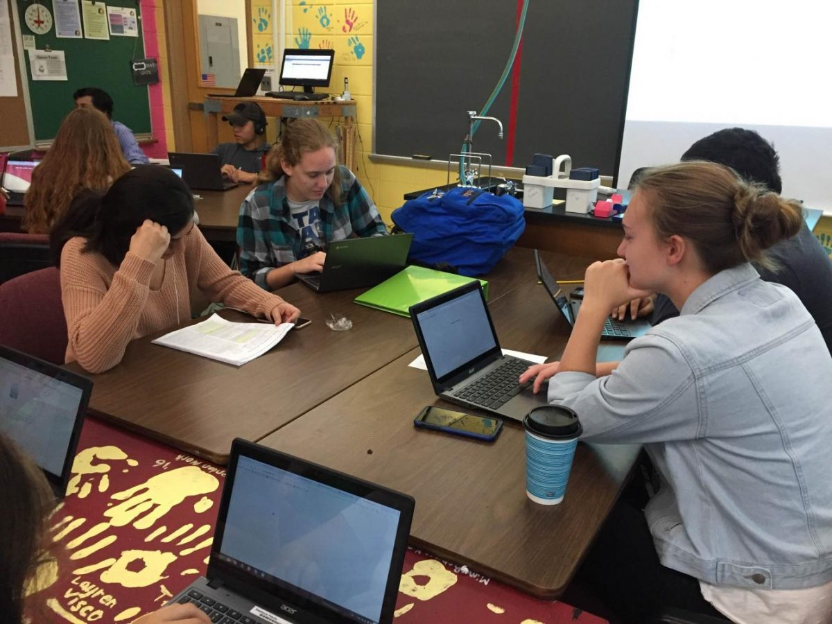 Seniors in Tessa Mazzeos homeroom work their way through a discussion of this years summer reads.