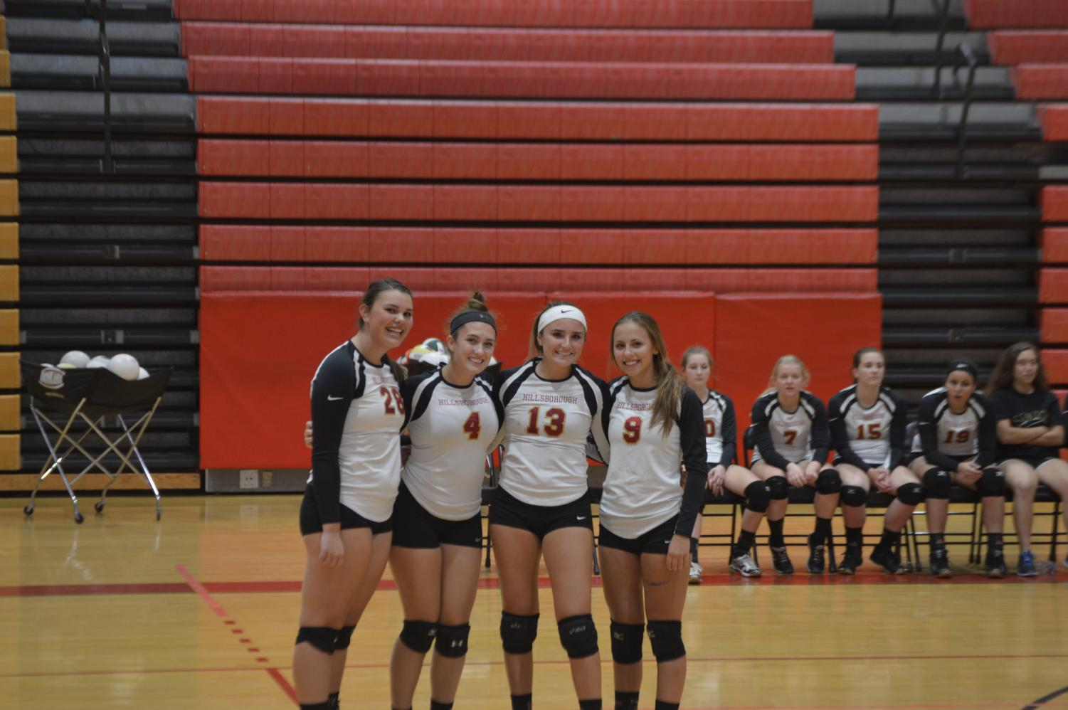 Senior Jillian Boose, juniors Gianna LoCicero and Lenah Chedid, and sophomore Morgan Krempasky quickly pose for a picutre during their senior night game.