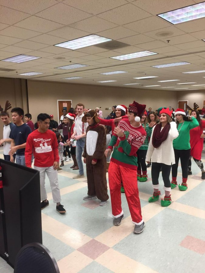 Members of Student Council dance along with the party attendees.