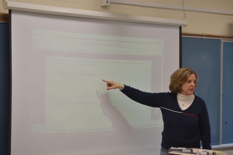 Math teacher Elizabeth Berliner reviews her midterm with her period 4/6 class.