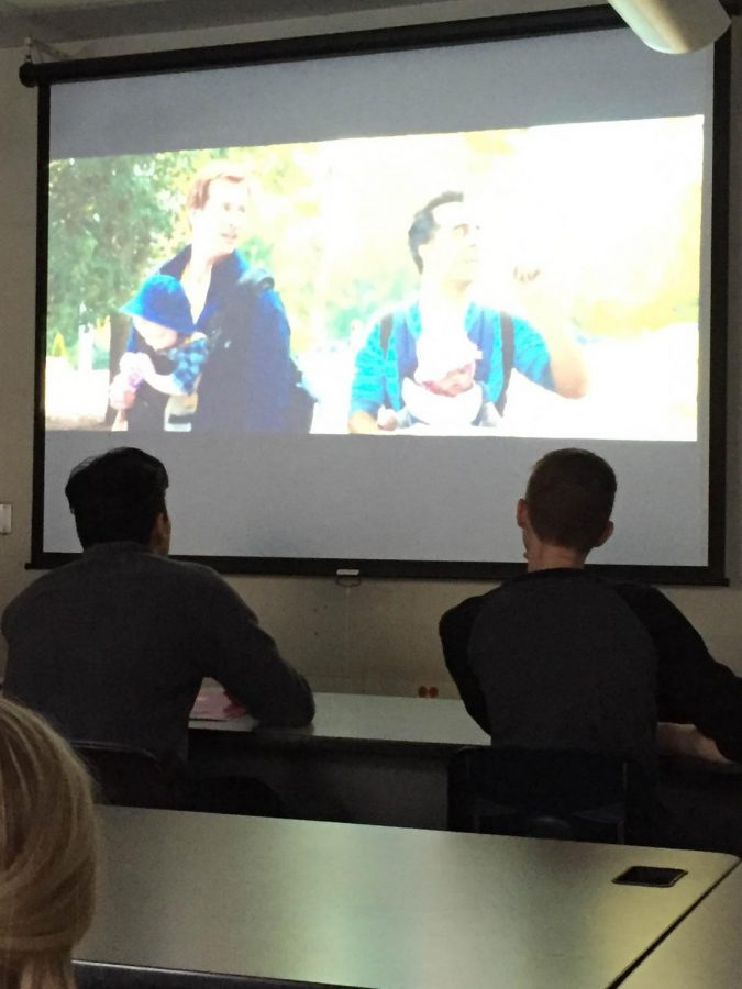 Seniors Aron Lauan and Justin Gumpel watch a parenting movie in their health class.