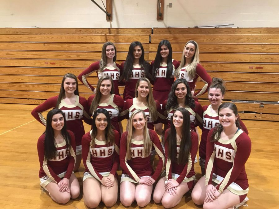 The winter varsity cheer team poses before cheering for the first time this winter.