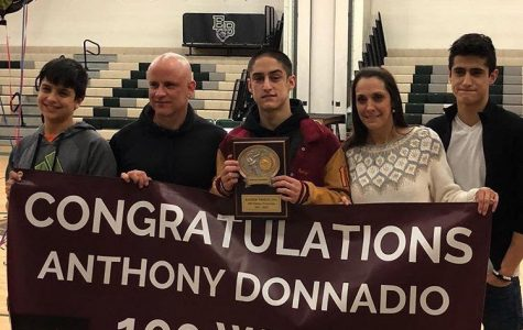 Donnadio wrestles his way to milestone 100th win