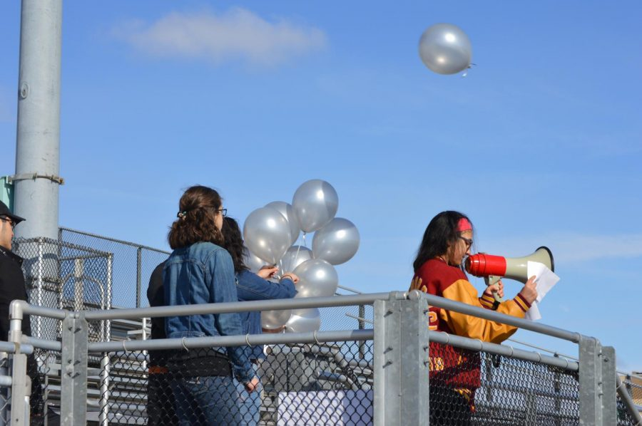 Students release 17 silver balloons in honor of the 17 victims of the Parkland shooting.