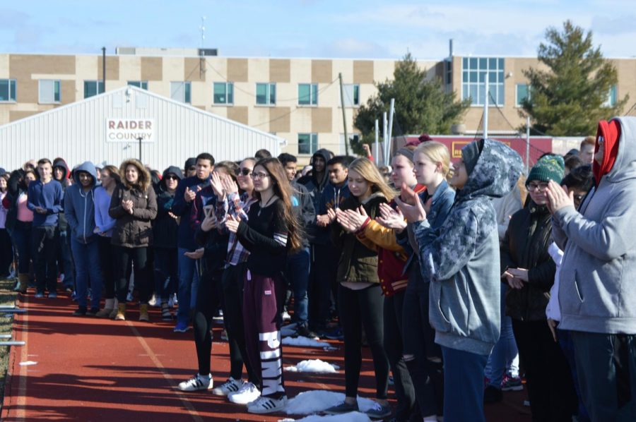 Students applaud the leaders of the walkout.
