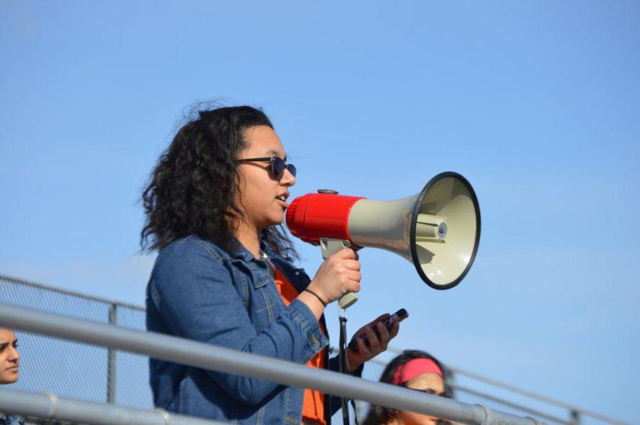 Sophomore Gabi Diaz recites a poem to the crowd.