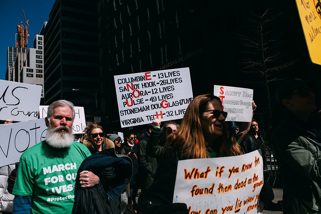 Marchers hold signs and walk through Washington D.C. to voice their opinions on the issue of gun violence in America.