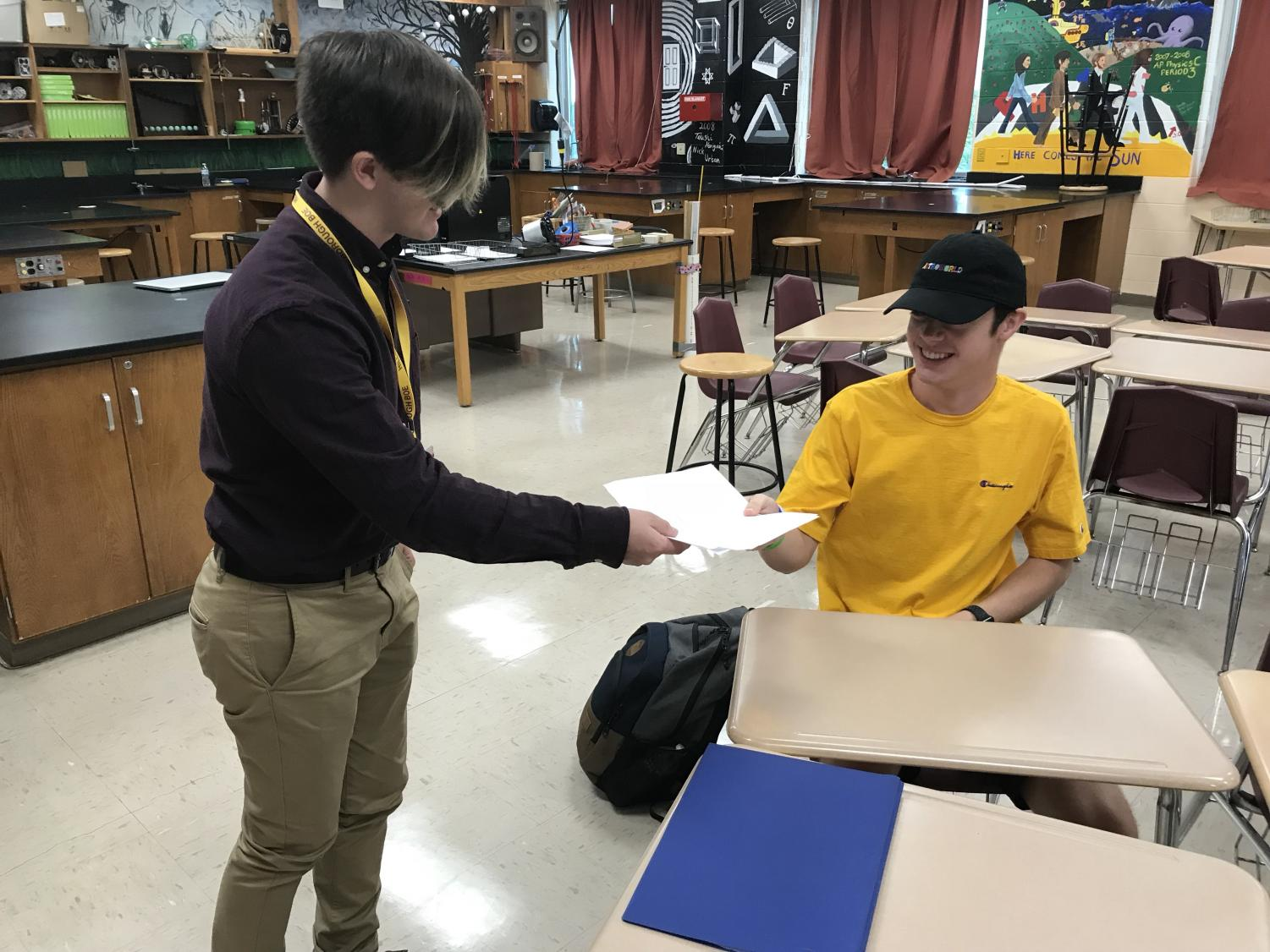Student teacher Bryan Miner helping senior Ryan Wilke with his engineering project.