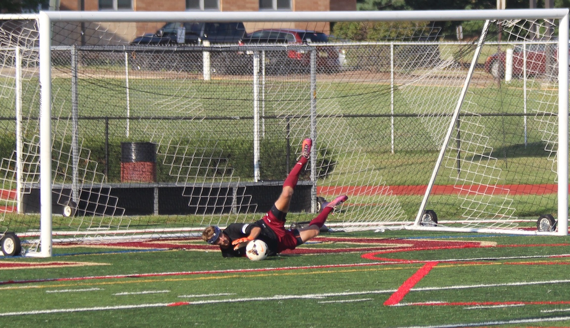Senior Nick Burd saves a penalty in the season opening win over Hunterdon Central.