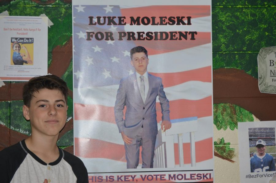 Freshman+Luke+Moleski+stands+in+front+of+one+of+his+campaign+posters.