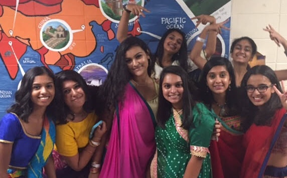 Garba goers pose for a picture.
