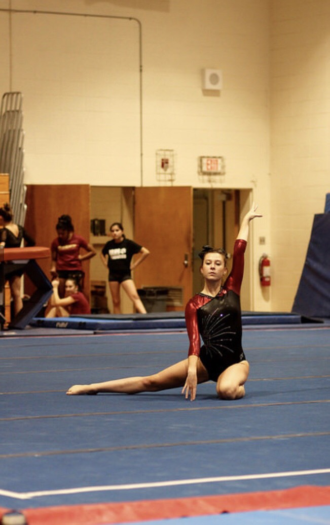 Senior Clare Hanlon preforms her floor routine.