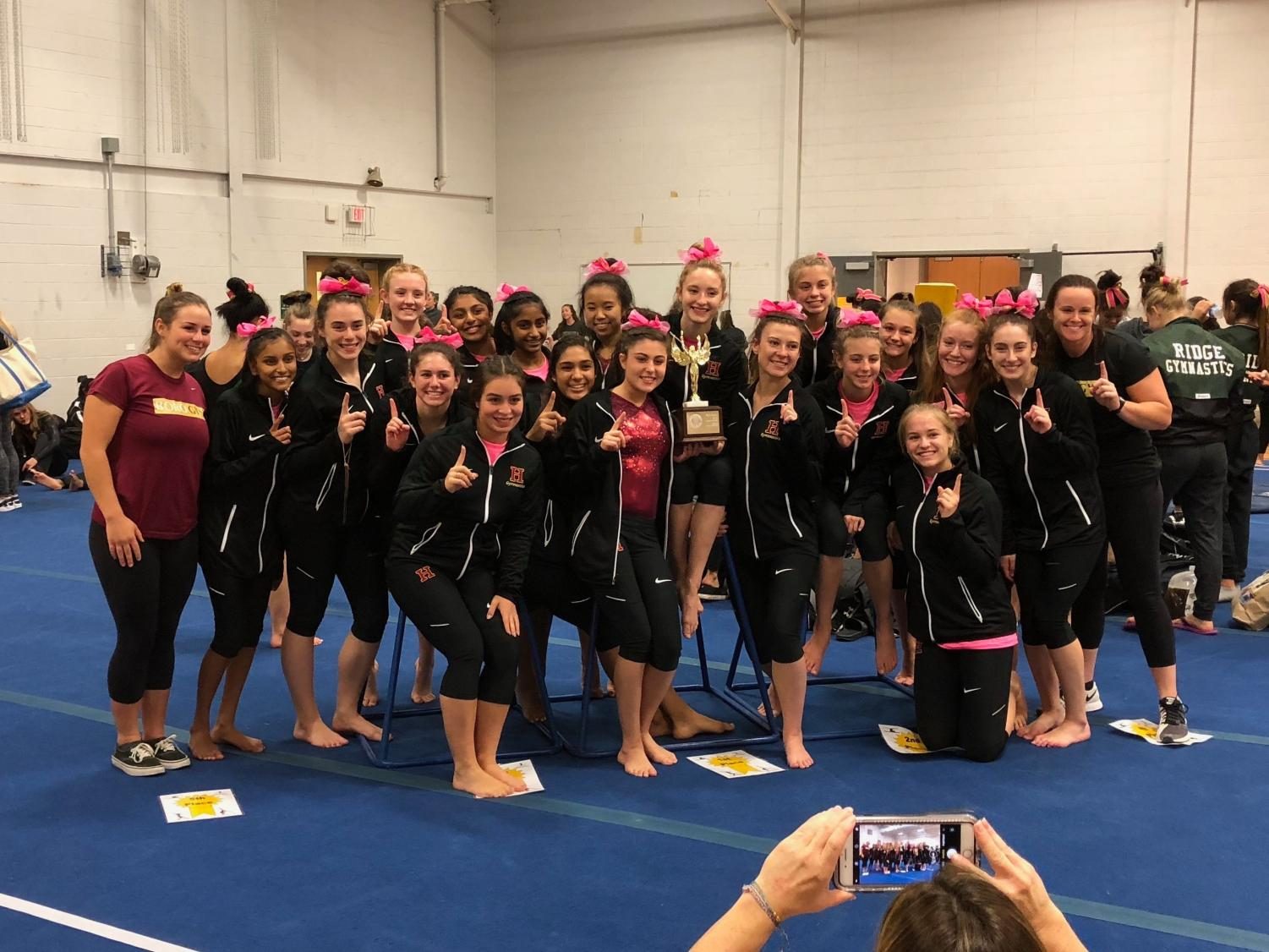 Raider gymnasts gather for a celebratory picture after capturing its fifth straight Somerset County Title.