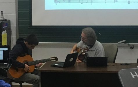 Guitar teacher Jonathan Klizas just might be the school's most interesting man