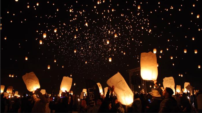 The sky lanterns take flight and illuminate the night sky at The Lights Fest.