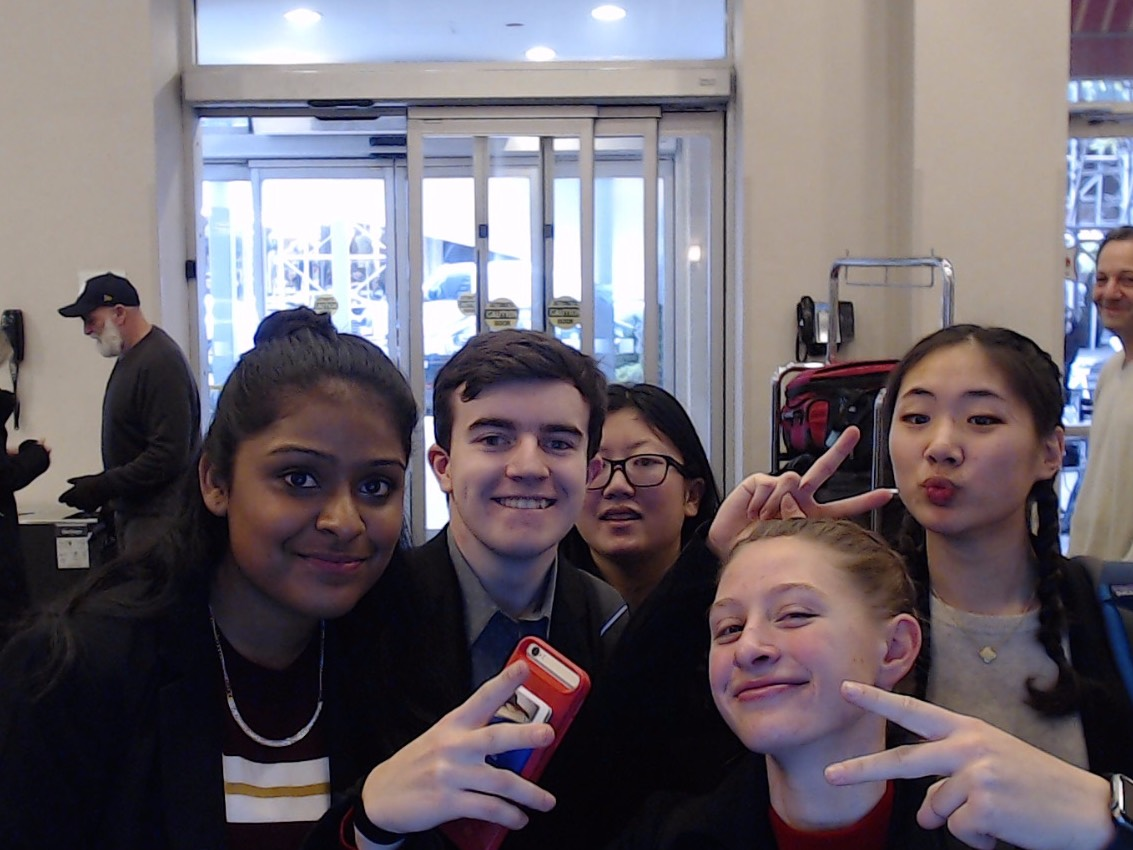 The victorious debaters, from left to right, Lasya Cheruvu, Dyrlan Warner, Teresa Buzzoni and Janice Lee pose for a picture at the competition held at NYU.