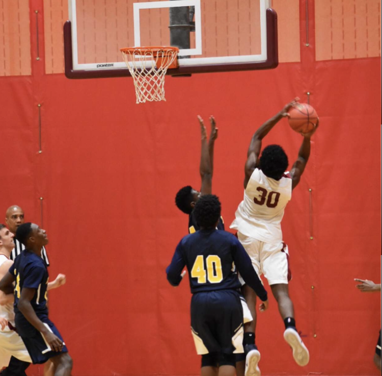 Junior Jared Smith going up for a layup against Franklin High School.