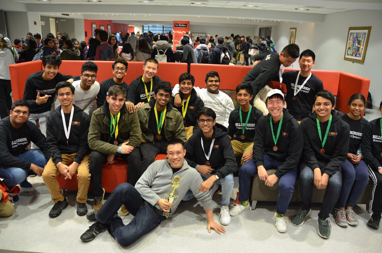 Science Olympiad poses for a celebratory picture after its strong showing at NJIT.