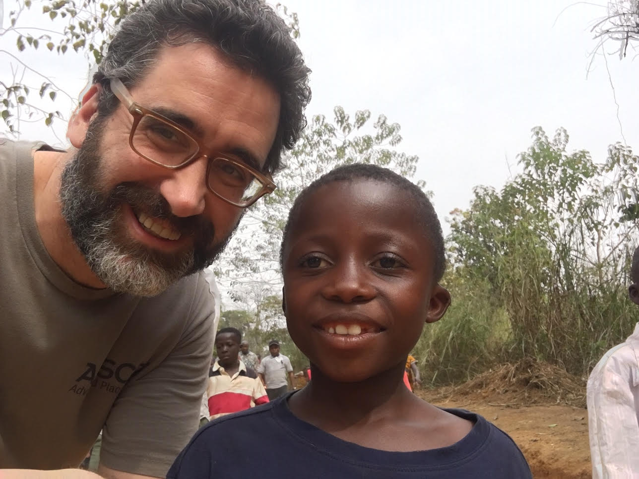 History teacher Robert Fenster in Africa climbing the Wara Wara Mountain with new friend, Ali.