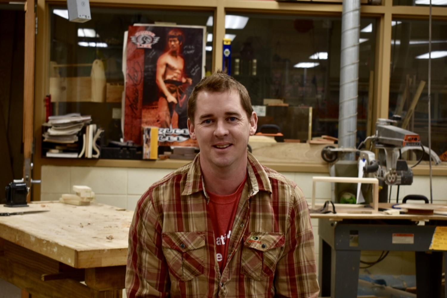 Eric Rosenthal poses in his woodshop. Rosenthal is a respected educator who consistently challenges his students to be their best.