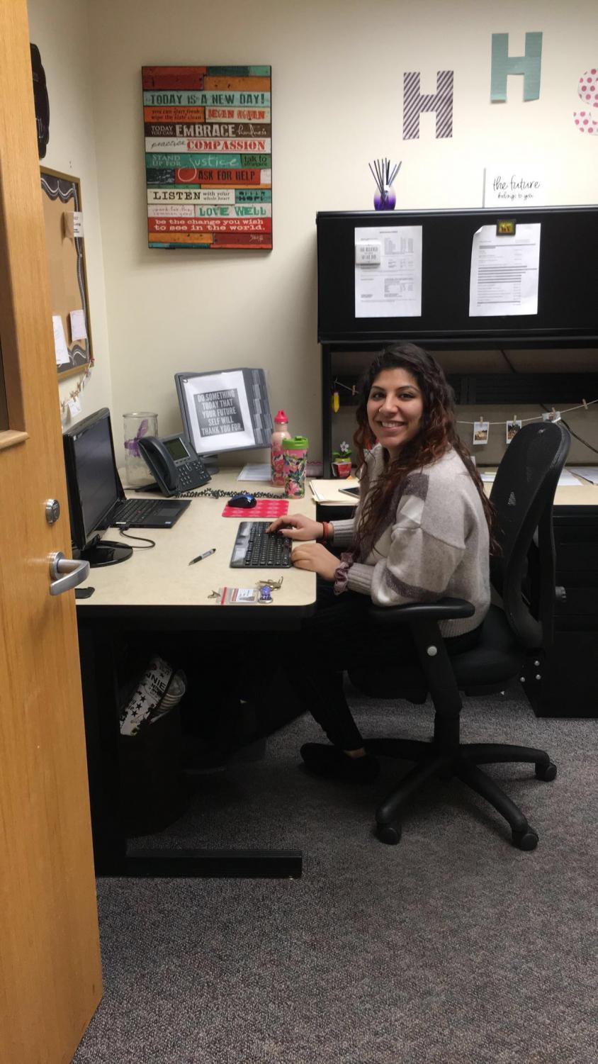 Trikha works on midterm schedules in her office located in the downstairs guidance office.