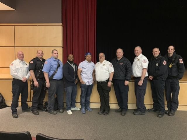 Alvaro+Llanos+and+Shawn+Simons%2C+who+presented+%22After+the+Fire%22%2C+stand+alongside+members+of+the+Hillsborough+Fire+Department.