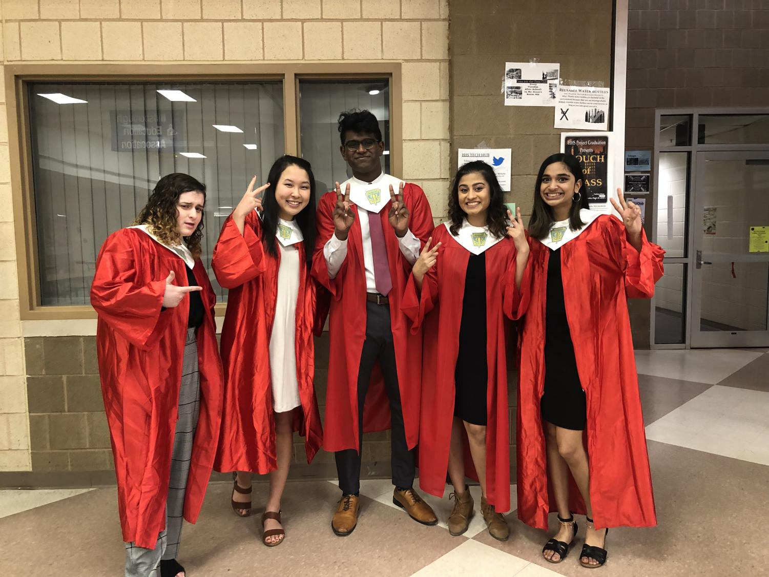 The executive board poses for a humorous picture before the ceremony. From left to right, seniors Lindsey Baum, Hanna Kim, Rupak Stephen, Meghan Patel and Mahitha Vivek.