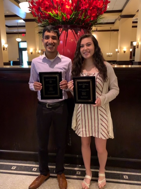 Shah and Seidel pose with their scholar athlete awards.