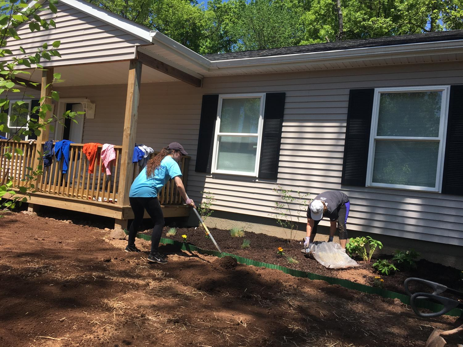 Senior Alexandra Mure constructs a garden for a family.