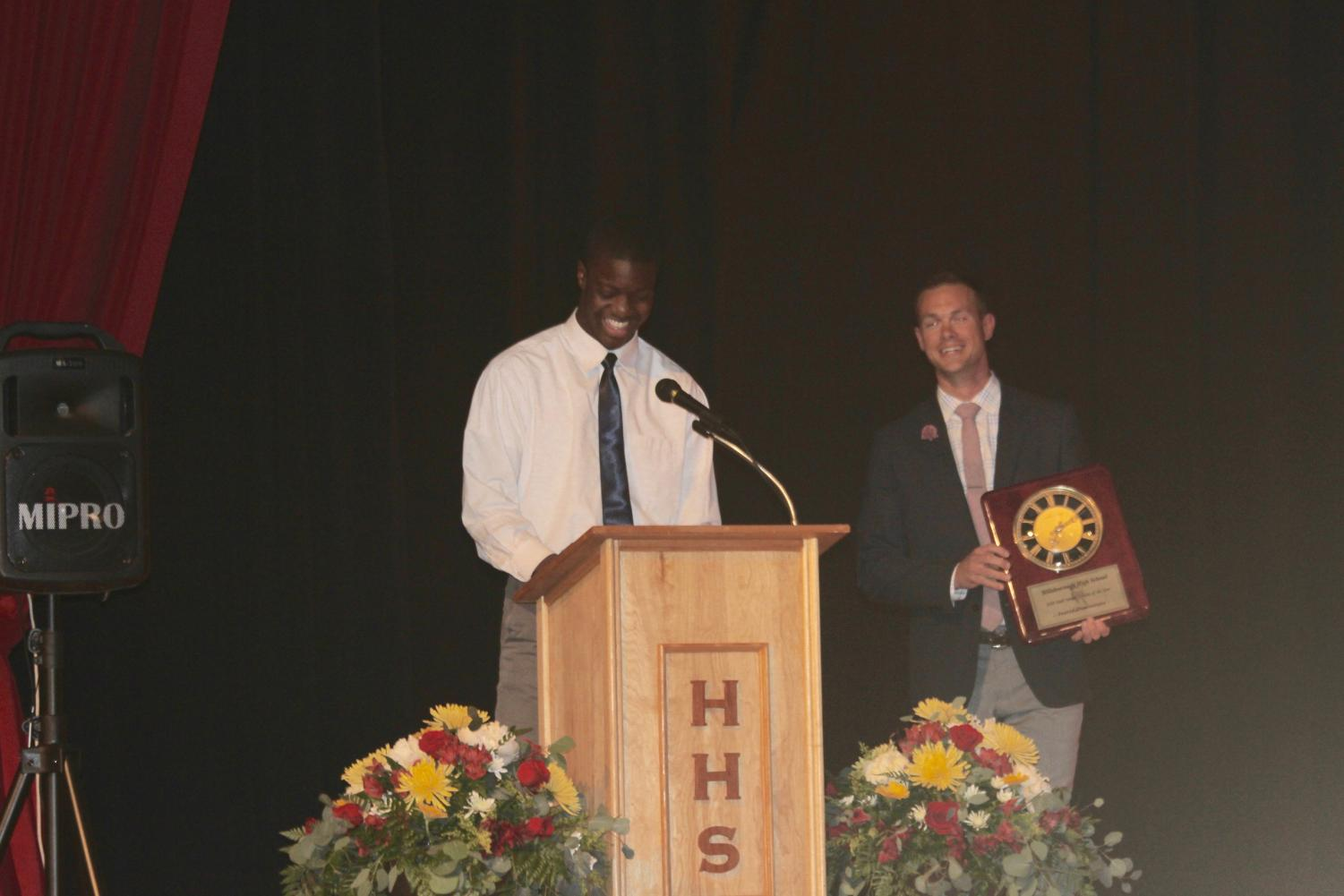 Dominique giving his speech for the Male Athlete of the Year award while Davis stands beside him, presenting Dominique's plaque.
