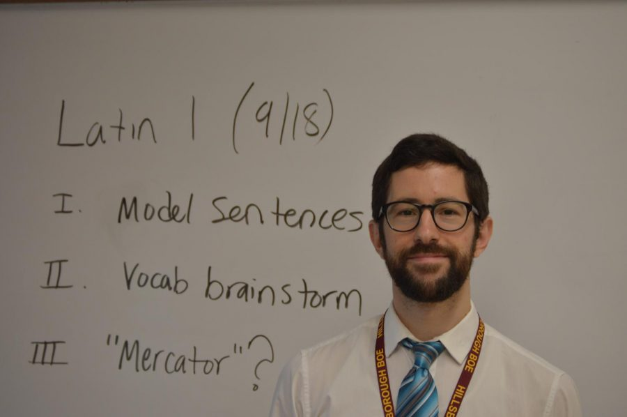 The+new+Latin+teacher+Brian+Mumper+is+all+smiles+during+his+first+semester+at+HHS.