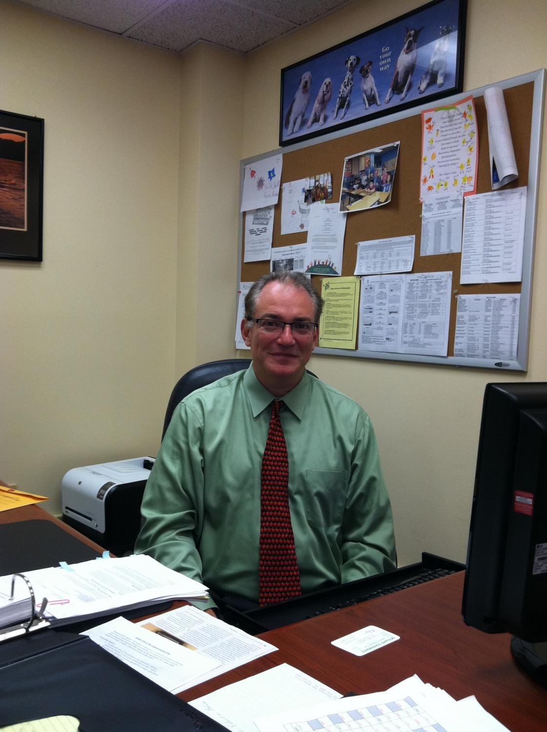 Dr. Schiff doing work at his desk where he's been leading the district since 2011.