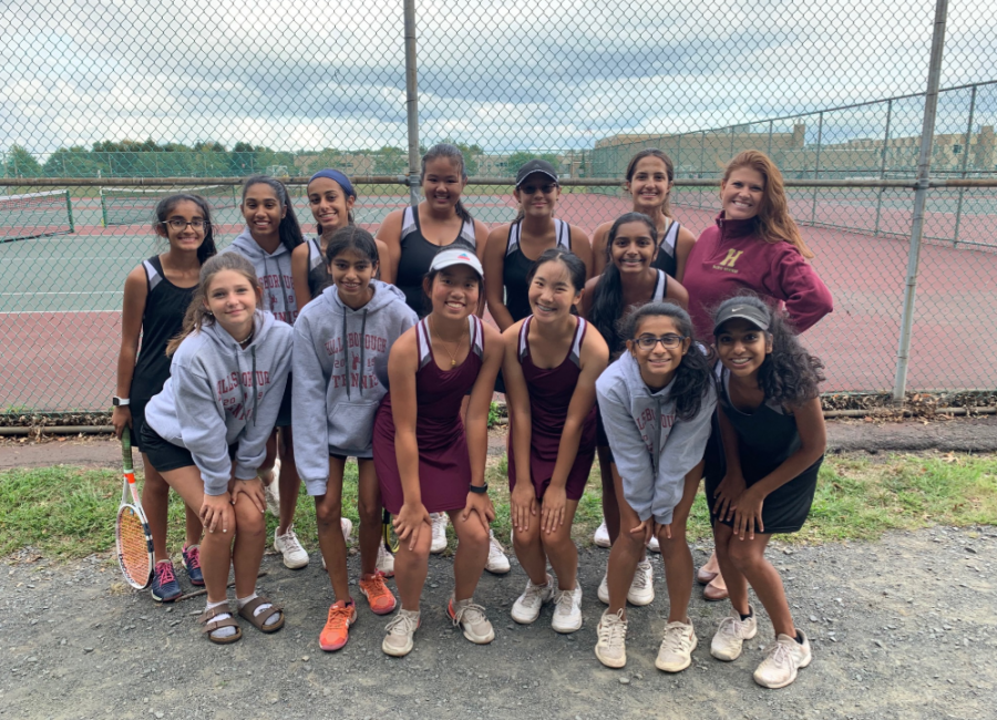 The girls tennis team is all smiles after an undefeated start to the 2019 campaign.