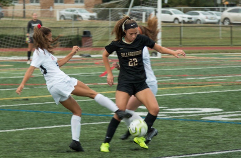 Senior Alexa Swetz fights for the ball in a recent contest.