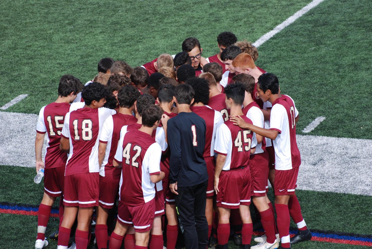 The boys soccer team takes instructions from head coach Eric Puma prior to a recent contest.