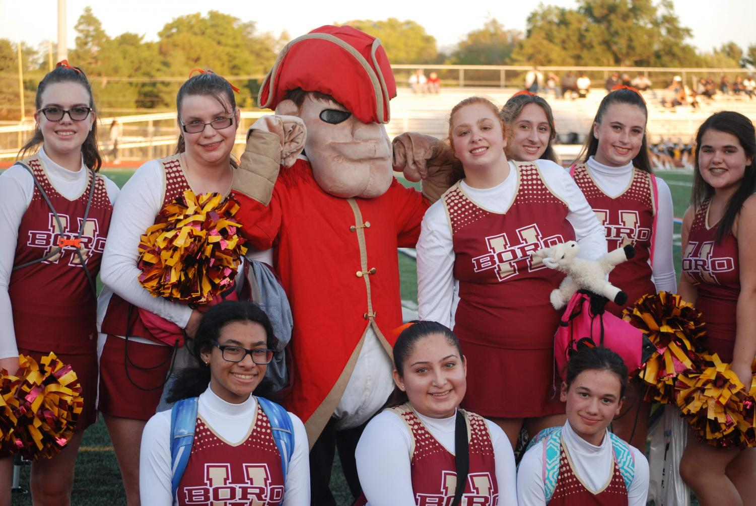 The Rockin' Raiders Cheer Team with the school mascot at the Franklin football game.