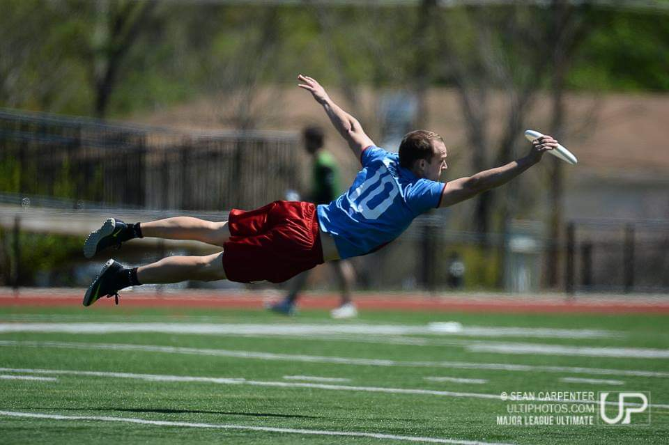 Casey catching a frisbee in mid-air during his years as a professional.