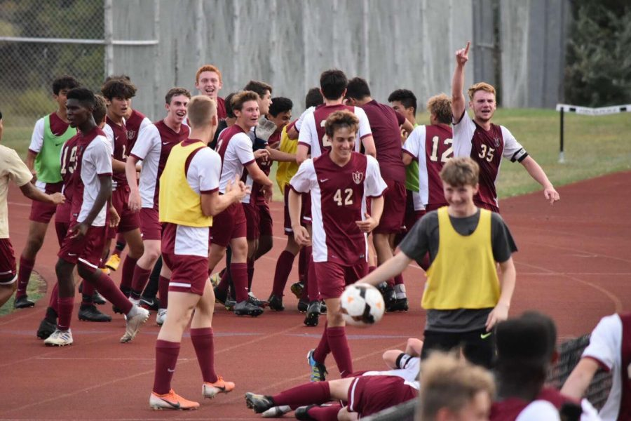 Boys+Soccer+celebrates+their+big+win+over+Pingry+after+a+double+overtime+clash.