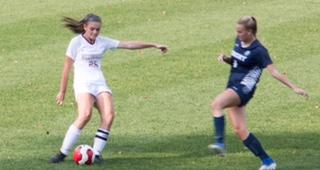 Senior Allison Watson plays defense vs Pingry.