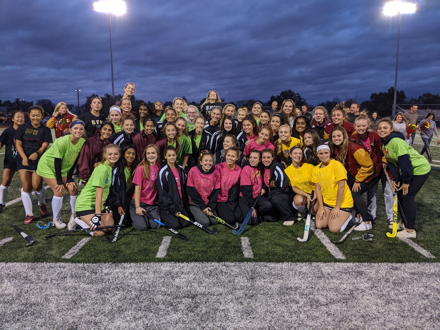 All three field hockey teams pose for a group shot at the opening ceremony for Senior Night.